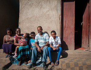 Abraham (middle in the blue shirt) and his family in front of their home in Adama, Ethiopia.