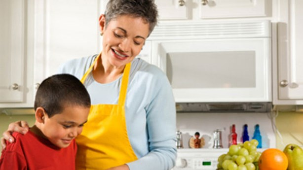Grandmother Teaches Grandson About Sealing Canned Goods