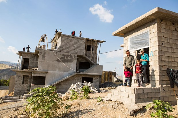 Hadi Ali and his family of nine are some of the thousands of displaced Iraqis now living in unfinished buildings in Kurdistan.