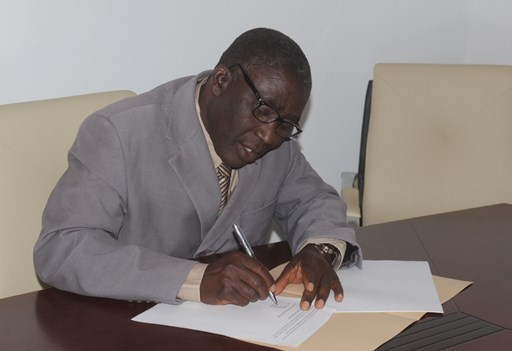 The Christian Association of Nigeria's general secretary, Musa Asake, signs the new declaration.