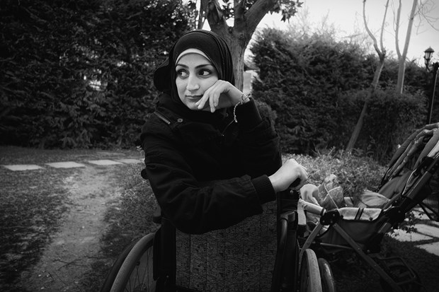 Athens: At Bethel, a retreat center and hostel in Athens run by Greek Scripture Union, Syrian and Yemeni refugees have been invited for excercise,  food, and rest before their journey toward Germany begins. This woman is in a wheelchair after being injured by a car bomb in Syria.