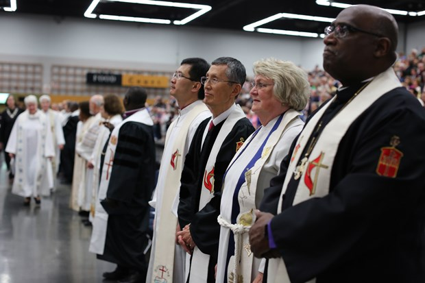 Bishops move to their places for opening worship. Photo by Kathleen Barry, United Methodist News Service