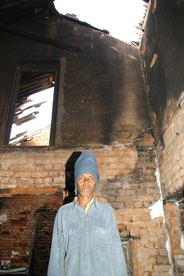 """John Pradhan's  home in Gurkapia village was ruled to be only """"partially damaged."""""""