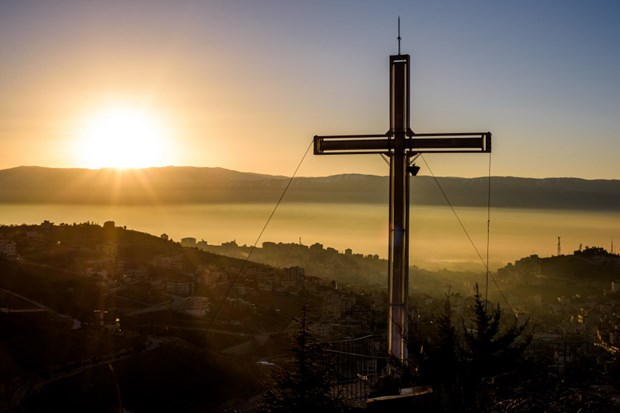 The sun rises over Zahle and the Bekaa Valley.
