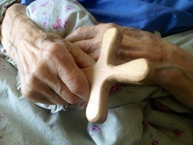 Roald Kverndal holds his new, hand-carved cross.