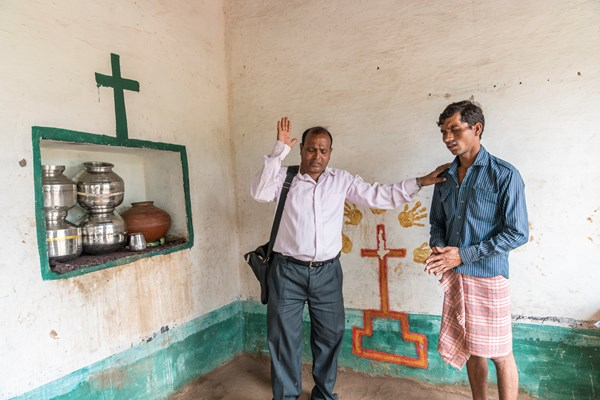 Pastor Bhagwana Lal spends his day praying with tribal families at their homes.
