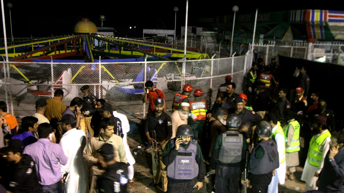 Pakistani police and rescue workers gather at the scene of the attack.