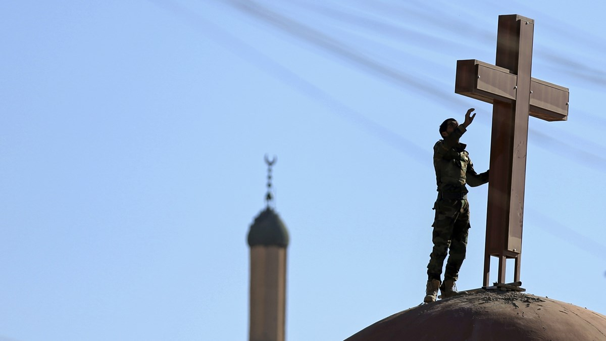 A cross is set on a church damaged by ISIS near Mosul, Iraq.