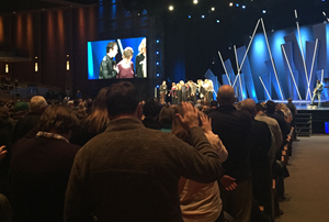 Members and elders pray for the Hybels family.