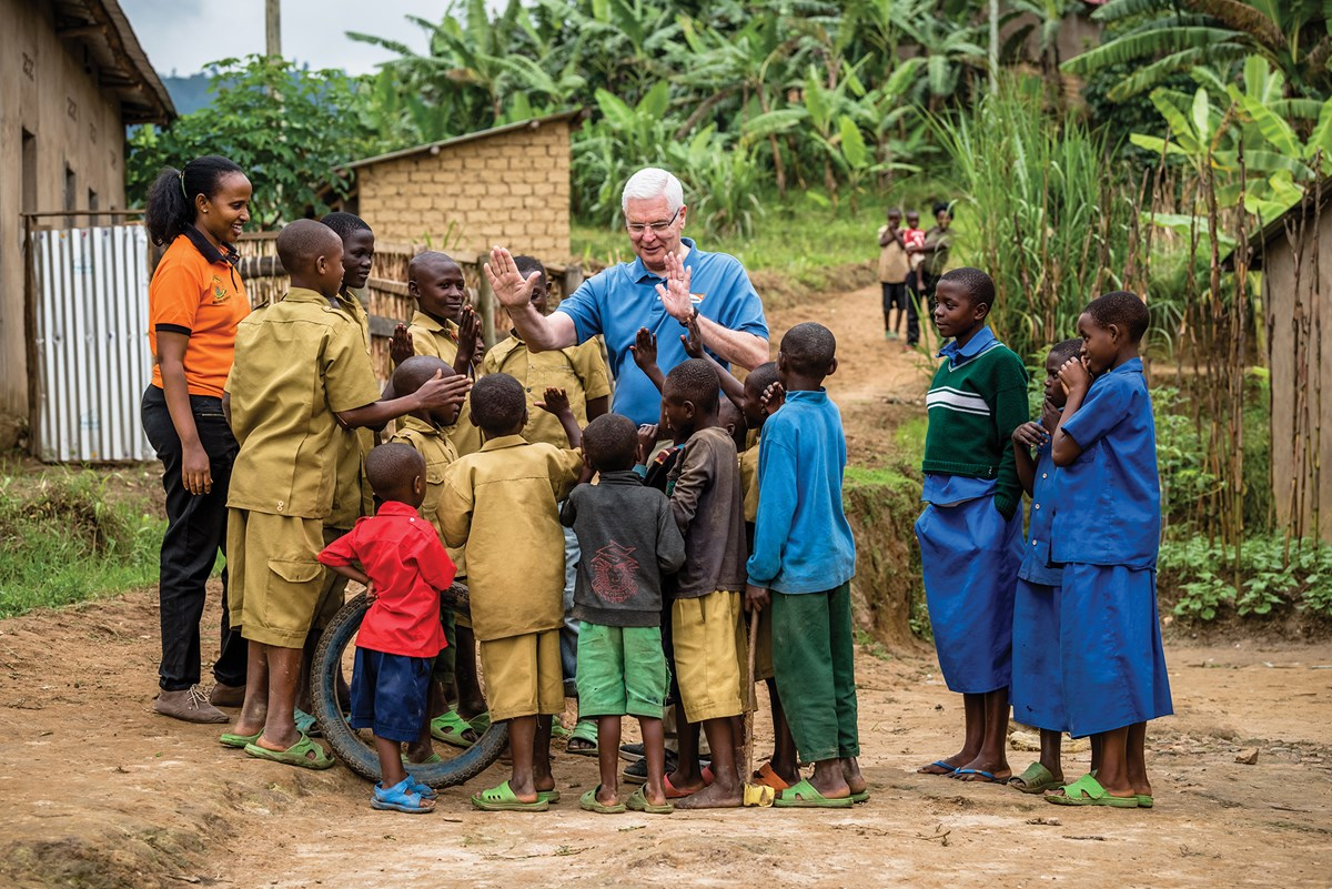 On his last field visit before retirement, Stearns meets sponsored children in Nyarutovu in northern Rwanda, where World Vision has launched an ambitious plan to bring universal access to clean water within five years.