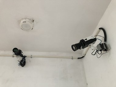 Security cameras with facial recognition technology, in the lobby of the Beijing building where Zion Church rents space.
