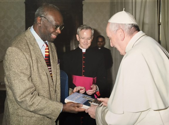 Lamin Sanneh presents Pope Francis with his last book, on jihad and pacifism in Muslim West Africa.