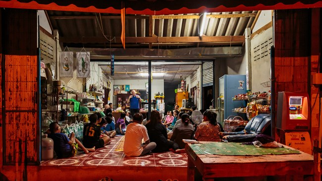 Researcher Dwight Martin (top) shares his testimony with new believers in a Thai house church that gathers in a local storefront.