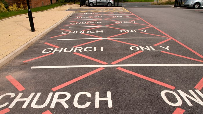 Pastor Parking Paves the Way for Controversial Church Taxes