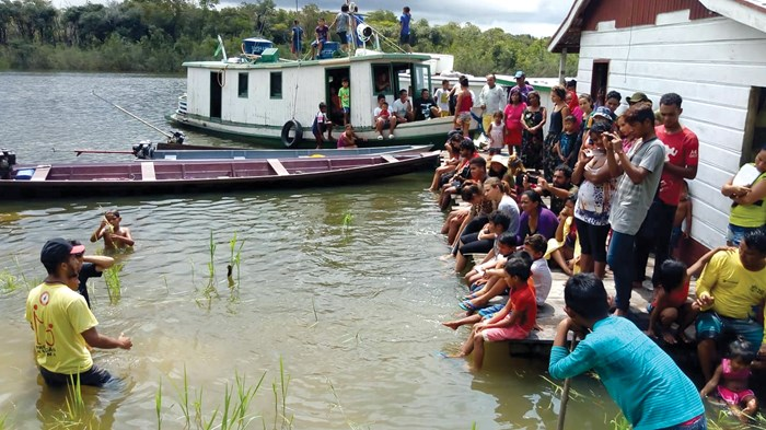 Young Christians from the Paumarí tribe gather for a baptism.