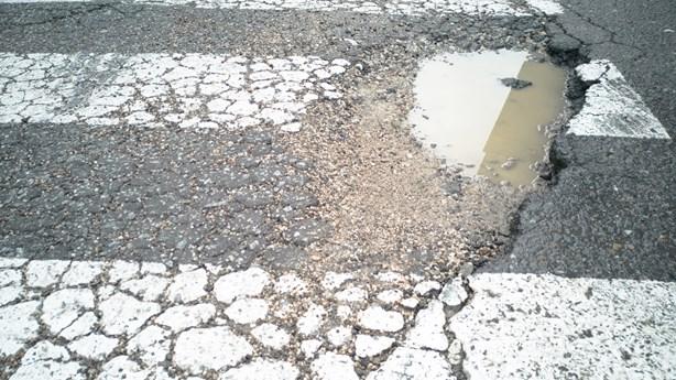 12-Year-Old Fills Neighborhood Potholes Himself