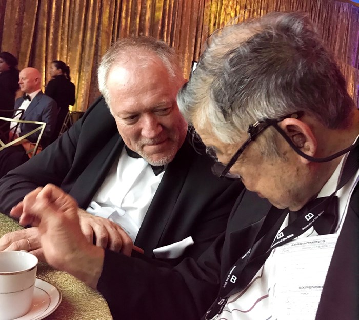 Edwin Yamauchi (right) asked David Trobisch (left) about the Mark fragment during the opening banquet at the Museum of the Bible.